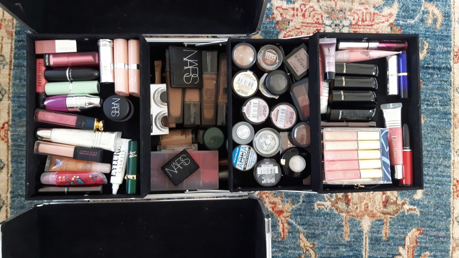 Amina's makeup box flatlay photo