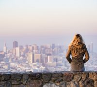 Woman looking over a city: why are there so few woman at the top?