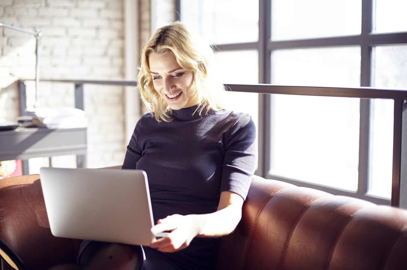 Woman on laptop, starting her own business, as featured in Focus Start Up Workshop